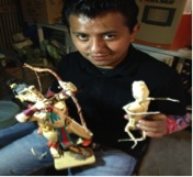 L: an example of one of Moises beautiful corn husk figures. R: a preliminary figure made to demonstrate his process
