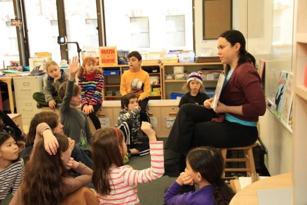 Interim children's librarian Allie Bruce discussing semifinalists with the 9/10s