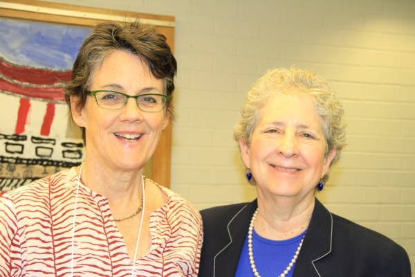 President Elizabeth Dickey (r.) greets Maggie Bradley, wife of Don Cook (for whom, together with Michael Cook, the Cook Prize is dedicated).